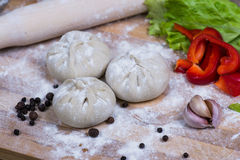 Caucasuan cuisine - Khinkali with meat served green koriander leaves.  Stock Image