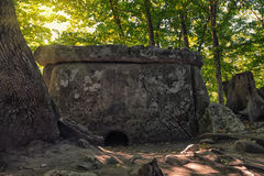 Caucasus dolmen. Ancient portal dolmen standing in scenic forest Stock Photos