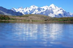 Caucasus mountain range in the reflection of the mountain la Royalty Free Stock Images