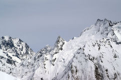 Caucasus Mountains. Grey sky. Caucasus Mountains. Dombaj Stock Photos