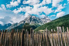 Caucasus mountains behind a wooden fence. On the background of the mountain peak Mazeri in Georgia Stock Images
