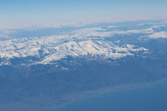Caucasus mountains and Caspian sea. View from the airplane. Royalty Free Stock Photography
