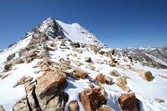 Caucasus mountains. Elbrus area. Rocks in snow. royalty free stock image