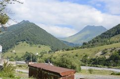Caucasus Mountains and The Georgian Military Road. With road shops stock images