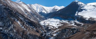 Caucasus Mountains pan. Mountain ridge Gimrinsky in Dagestan. South of Russia, the North Caucasus. The place where the mountain stream begins Apki-Ozen Royalty Free Stock Image