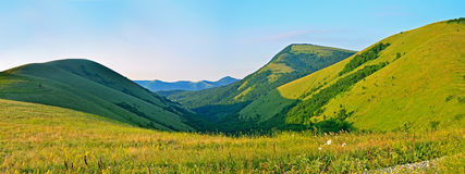 Caucasus Mountains in summer, panoramic view Stock Photos