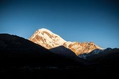 Caucasus Mountains, tourism, sunset, Kazbek Royalty Free Stock Photos