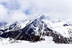 Caucasus mountains under fluffy snow royalty free stock image