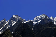Caucasus mountains under snow and clear blue sky Royalty Free Stock Photos