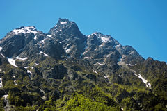 Caucasus mountains under snow and clear blue sky Stock Images