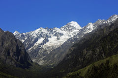 Caucasus mountains under snow and clear blue sky. A Caucasus mountains under snow and clear blue sky Stock Image