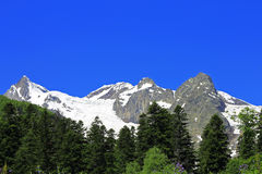 Caucasus Mountains Under Snow And Clear Blue Sky. A Caucasus Mountains Under Snow And Clear Blue Sky Stock Images