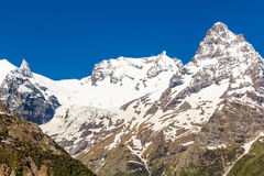 Caucasus mountains under snow stock images