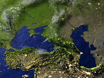Caucasus region at night on realistic model of Earth Stock Photos