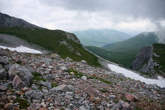 Caucasus rocky screes. Rocky screes and snow in the Caucasus mountains royalty free stock photos
