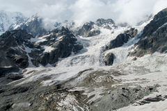 Caucasus snow and rocky peaks landscape Royalty Free Stock Photo