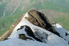 Caucasus snow and rocky peaks landscape Stock Photos