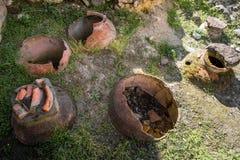 Old broken clay wine jugs in georgia stock photos
