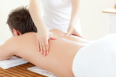 Caucsasian young man having a back massage Royalty Free Stock Image