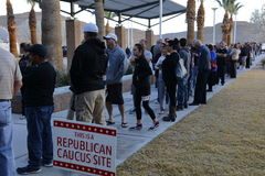 Caucus goers and voters wait in line to enter a caucus location in Las Vegas, Nevada, U.S., on Tuesday, Feb. 23, 2018 Stock Image