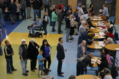 Caucus goers and voters wait in line to enter a caucus location in Las Vegas, Nevada, U.S., on Tuesday, Feb. 23, 2027 Royalty Free Stock Image