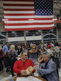 Caucus goers and voters wait in line to enter a caucus location in Las Vegas, Nevada, U.S., on Tuesday, Feb. 23, 2022 Stock Image