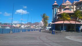 Caudan Waterfront & x28;Mauritius& x29;. This is the heart of Mauritius. The view of the harbour and architecture under the blue sky adds a magical twist to this Royalty Free Stock Photo