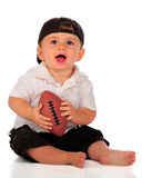 Caught It!. An adorable baby boy holding a pint-sized football. Isolated on white royalty free stock photography