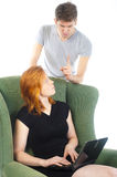 Caught in the act. A women is caught in the act by a men, what is she doing at the computer Royalty Free Stock Photography