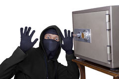 Caught burglar. Catch the burglar concept, thief with balaclava caught in front a vault Royalty Free Stock Photo
