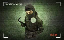Burglar in action. Caught burglar by house camera in action stock image