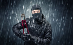 Caught burglar by house camera in action. Burglar in action in black clothes with rainy concept royalty free stock photo