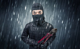 Caught burglar by house camera in action. Burglar in action in black clothes with rainy concept Stock Photography
