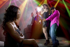 Caught Cheating At A Nightclub. Black male cheating on girlfriend with seductive white female at club Royalty Free Stock Photos