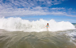 Caught In The Crashing Wave Royalty Free Stock Photos