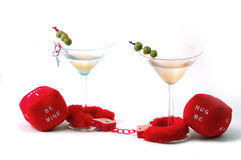 Caught In Love. Valentine's Day image depicting the concept Caught in love. Lace doilie hearts and furry handcuffs and Martini's stock photography