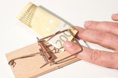 Caught!. Mousetrap with fingers and 200-Euro-Note Royalty Free Stock Images