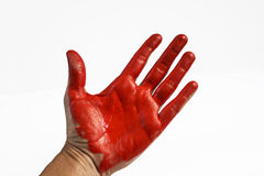 Caught red handed. Hand and palm covered in bright red paint, resembling blood or thief and stealing concept royalty free stock photos
