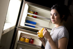 Woman Caught Snacking on Fruit Late Night  Stock Photo