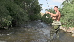 Caught Trout. Fisherman pulls out of the water trout. He is very happy stock video footage