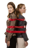 Caught up in red tape Royalty Free Stock Image