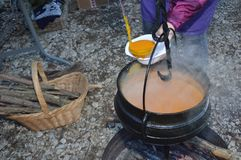 Cauldron,Caldron with hot soup. On a christmas market stock images
