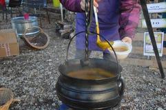 Cauldron,Caldron with hot soup on a christmas market. Zoom on a Cauldron,Caldron with hot soup on a christmas market royalty free stock photos