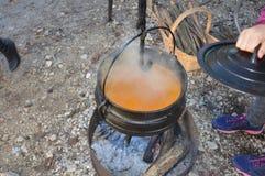Cauldron,Caldron with hot soup on a christmas market. Zoom on a Cauldron,Caldron with hot soup on a christmas market royalty free stock image