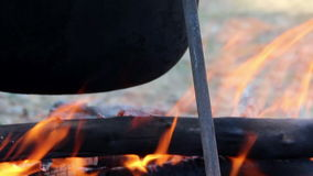 Cauldron on campfire stock footage