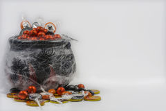 Cauldron with candies hallowen. Stock Images