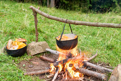Cauldron with cooking boiling on the fire Stock Images