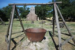 Cauldron for cooking on fire in the museum-skansen Stock Image