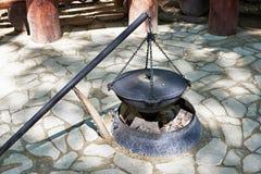 Cauldron for cooking over campfire. Cauldron for cooking over a campfire Stock Photos