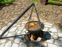 Cauldron for cooking over campfire Stock Photo